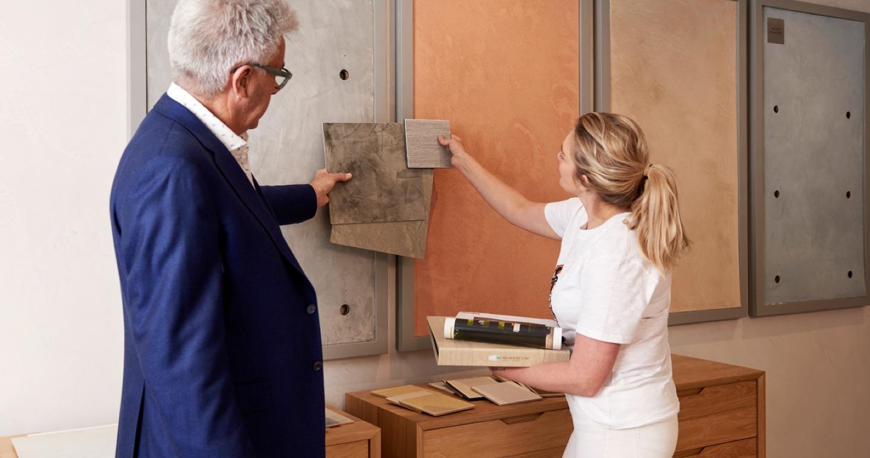 john bishop showing designer through the showroom at bishop master finishes