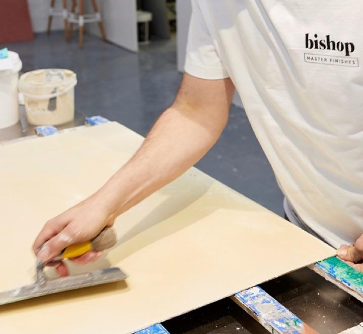 eddie bishop applying plaster in the warehouse at dover st cremorne