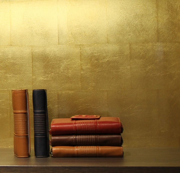 Gold leaf wall finish in front of luxury wallets at crown casino shop melbourne