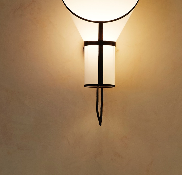 polished plaster wall finish gold wax light fitting