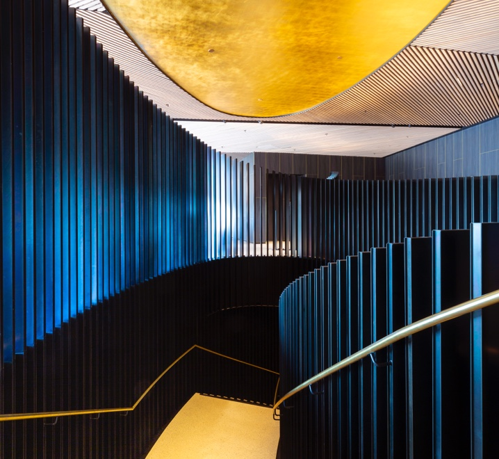 Gold leaf ceiling hand applied with deep blue balustrade above the staircase at RACV Cape Schanck