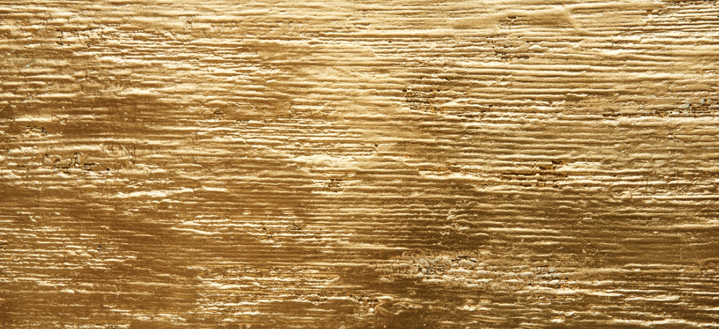 closeup of loretto bamboo like wall finish with gold
