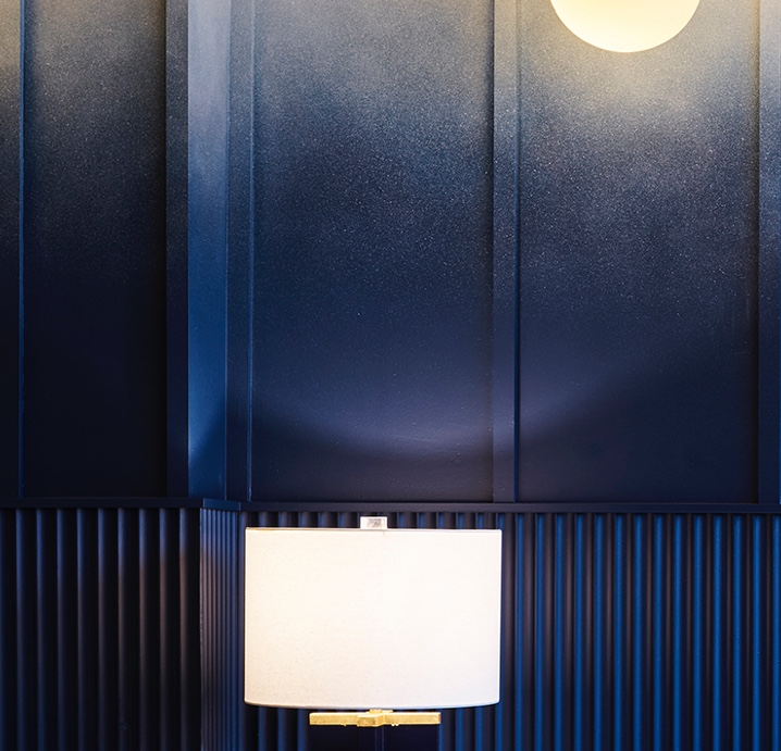 A closeup shot of the le plonc blue ombre wall designed by Greg Natale