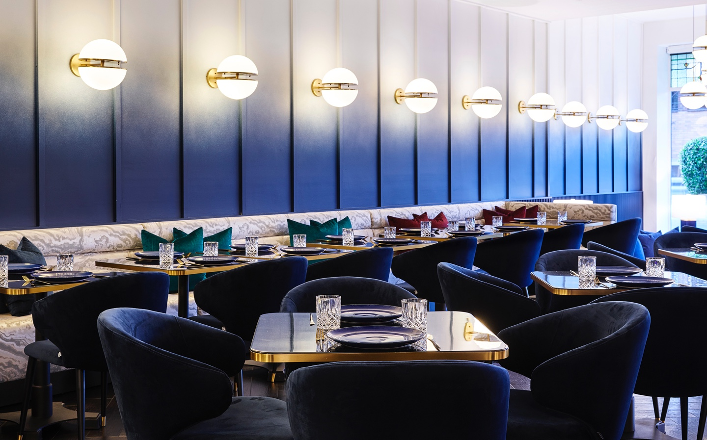 A wide shot of the le plonc blue ombre wall in the dining area designed by Greg Natale